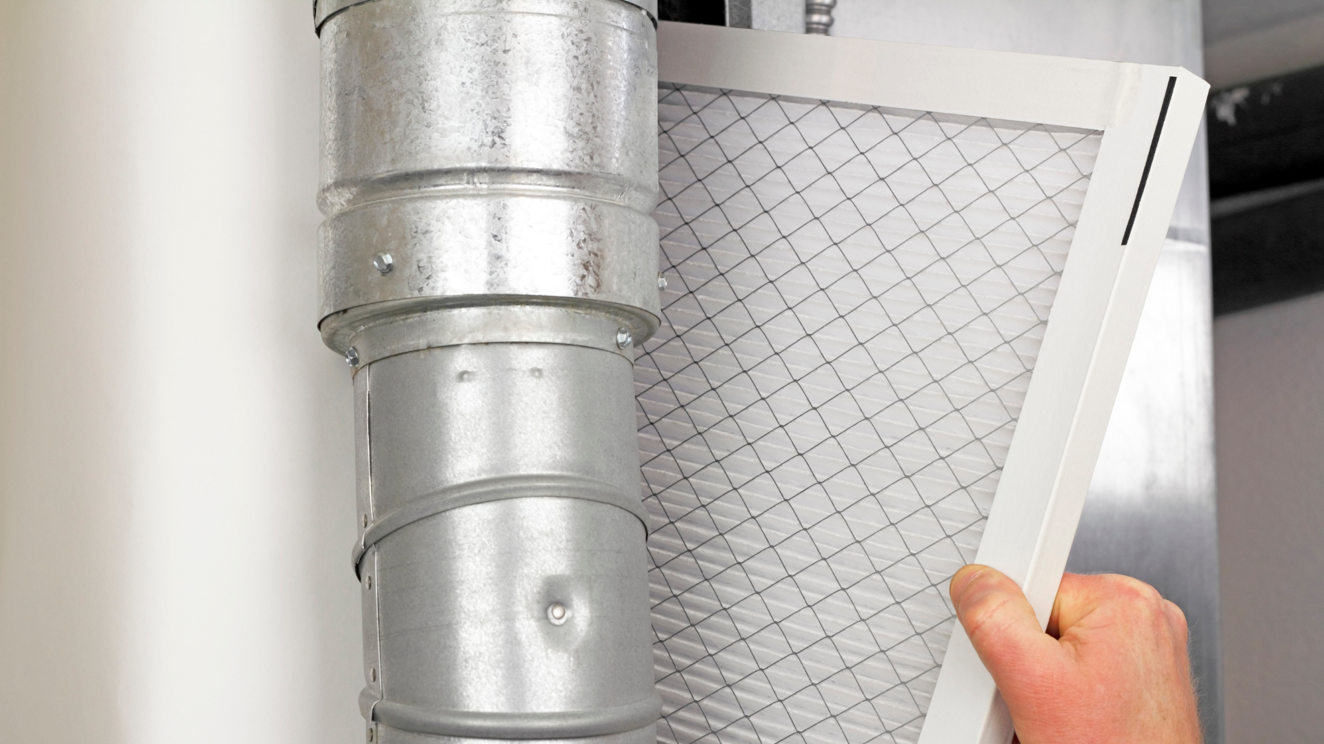 kma electric and heating & cooling technician changing furnace filter